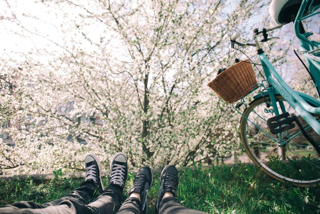 Shoes Laying on Grass with Bike