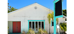 Vacant Teal Building with Sign