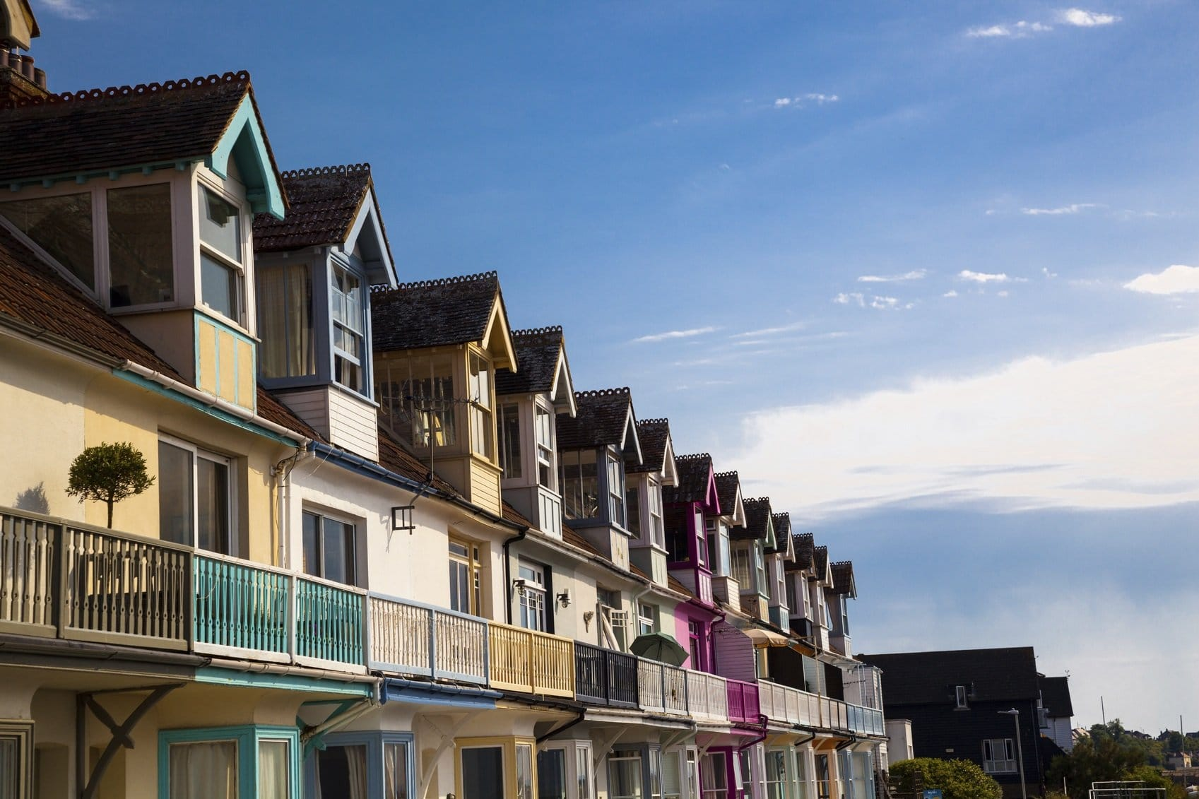 colourful holiday seaside apartments in summer sun england