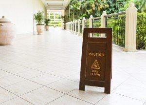 sign on floor that alerts for wet floor.